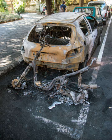 trashed: act of vandalism that ruined by a fire two vehicles