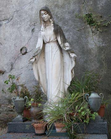 mother god: Madonna, virgin over a grave Stock Photo