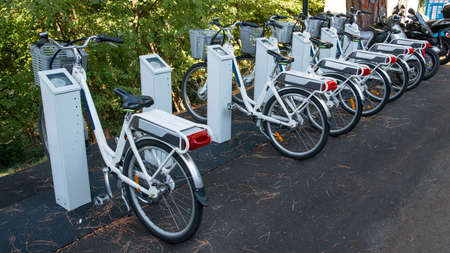 motorized bicycle: bicycle rental service subscription as an alternative to mobility Stock Photo