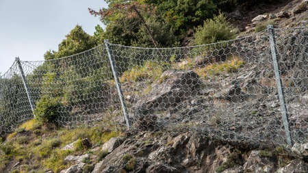 containment: wire containment mesh repair constructed for the passage of vehicles by landslides