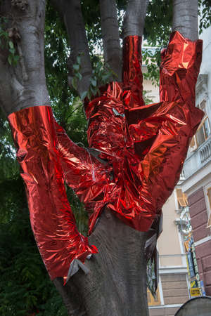 tree covered with red paper Stock Photo