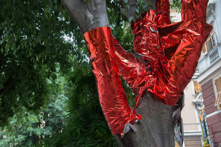 adherent: tree covered with red paper Stock Photo