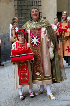 Passed out: GENOA, ITALY - 8 JUNE 2014 - Unidentified people during the historical parade of the Maritime Republics Palio