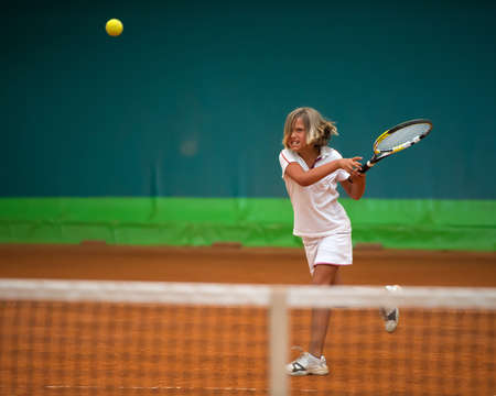 Children at school during a dribble of tennis photo