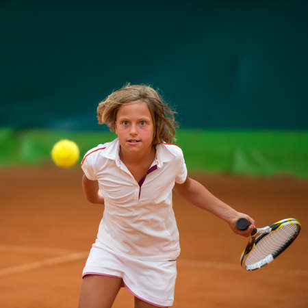 summer sport: Children at school during a dribble of tennis Stock Photo