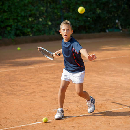 Children at school during a dribble of tennis Imagens