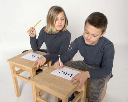 intent: Children intent on solving a problem of calculation Stock Photo