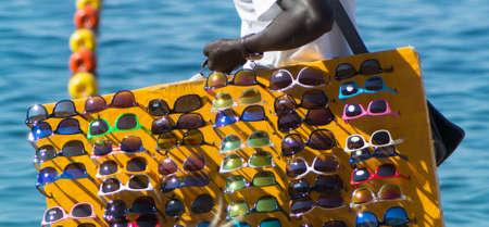 immigrant: immigrant peddler of sunglasses in summer