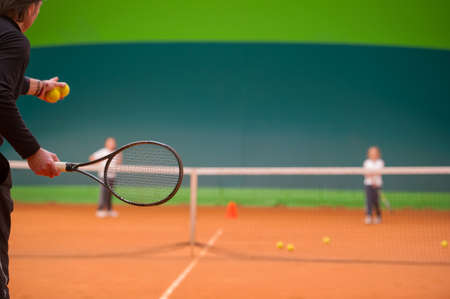tennis: tennis instructor during his work