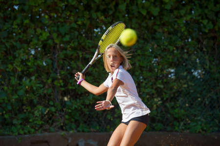 Children at school during a dribble of tennis Stock Photo