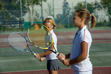 tennis skirt: Children at school during a dribble of tennis Stock Photo
