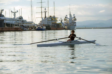 individual sport: Child in the course of rowing on single Stock Photo