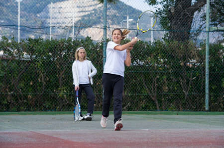 dribble: Children at school during a dribble of tennis Stock Photo