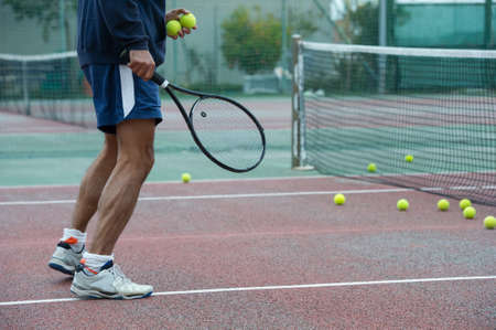 dribble: outdoor tennis coach ready for a dribble Stock Photo