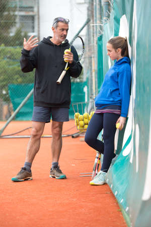 Children at school during a dribble of tennis Редакционное