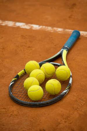 seven tennis balls on racket