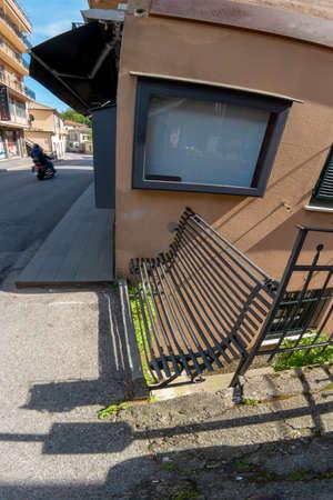 old iron bench on the street Фото со стока