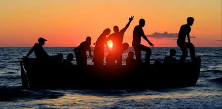 vindictive: boat with migrants fleeing the war Stock Photo