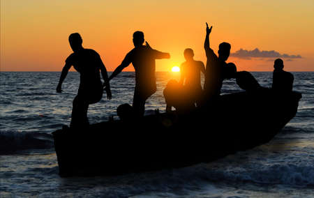illegal immigrant: boat with migrants fleeing the war Stock Photo