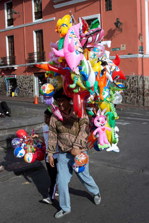 buoys: Inflatable toy seller in the Plaza de la Merced in Quito Editorial