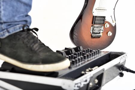 guitar effects equipment on white background.