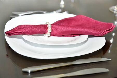 white plate with red napkin.