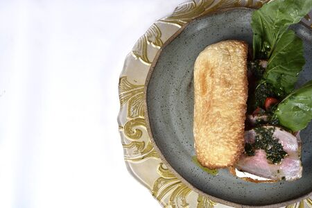 Beef sandwich with rucula, cherry tomatoes and pesto.