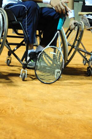 physically disabled athlete playing tennis in wheelchair Banco de Imagens