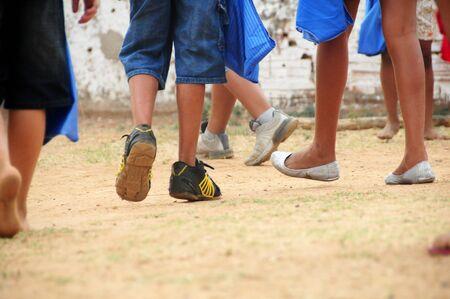 poor kids legs running and playing Zdjęcie Seryjne - 134749708