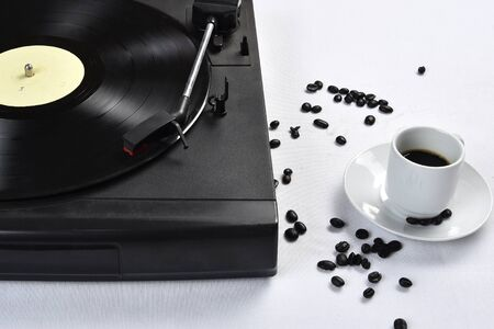 Old vinyl record with coffee.