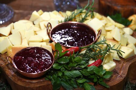 cheese served with red berry jam with photo blur