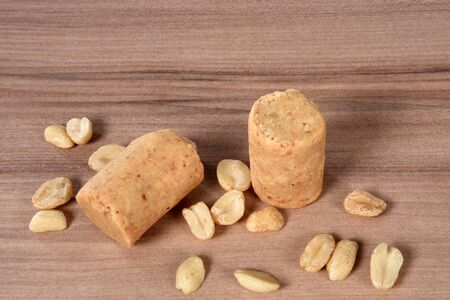 delicious brazilian peanuts peanut butter typical of june party isolated over wooden table