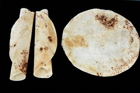 flatbread puff pastry isolated on black background
