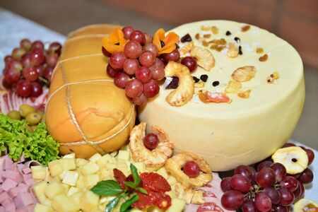 party table with cheese, chestnut, grapes, ham provolone Zdjęcie Seryjne