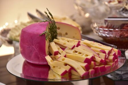 party table with gouda parmesan chees meadow freshness cut into strips with side view with blur in the photo 免版税图像