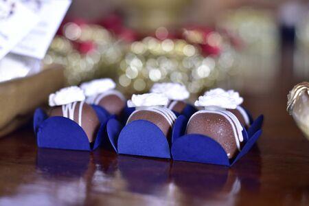 party chocolate candies in blue packaging on defocused background