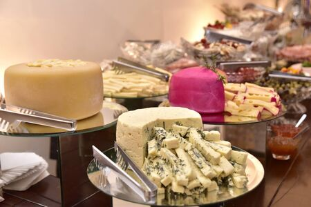 party table with gouda parmesan chees meadow freshness cut into strips with side view with blur in the photo Zdjęcie Seryjne
