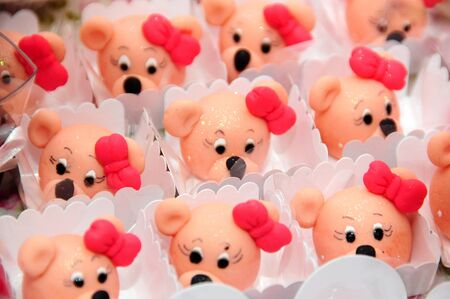 bear-shaped candies with a bow on the head with blurs
