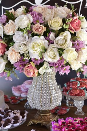 floral arrangement, bouquet of red and white flowers in glass vase