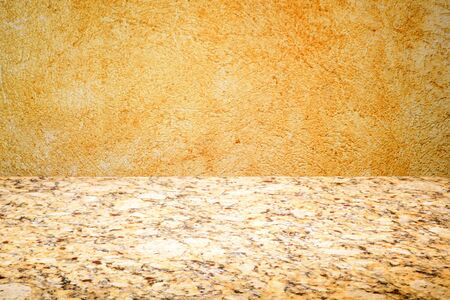 marble stone table top on yellow paint texture background with space for text Zdjęcie Seryjne