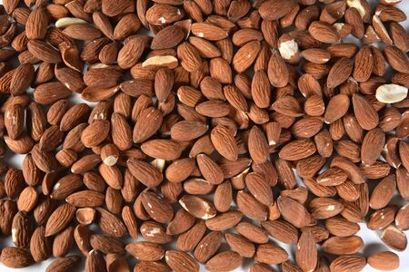 nutritious natural almonds scattered on the table in aerial view.