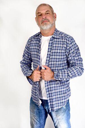 white bearded gentleman in white casual t-shirt jeans standing on white background Reklamní fotografie