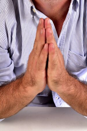 photo of mister adult man with white beard with hands together in prayer position on white background Reklamní fotografie