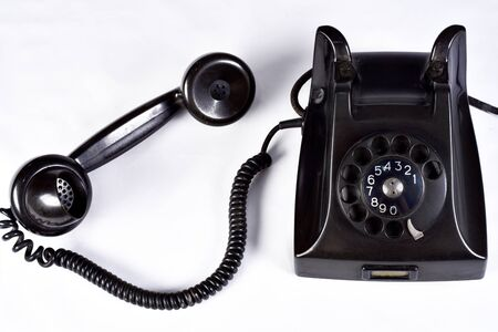vintage black old telephone handset on white background.