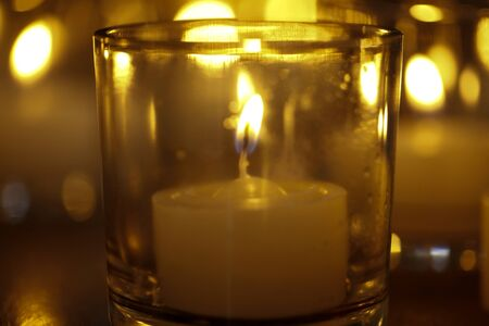defocused decorative light candles and candles for texture background