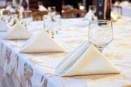 beautiful party dinner table with napkins bowls on blurred background