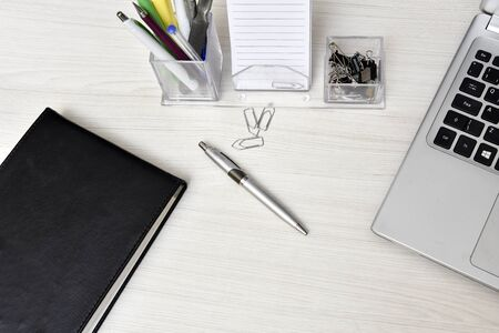 office desk with laptop service agenda pens pencils office utensils on the table with space for text