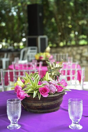 beautiful decorative arrangement of natural flowers on the table on blurred background