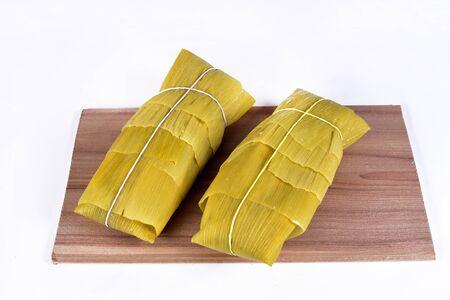 pamonha, corn mush, traditional corn cake culinary brazilian food, top view on white background