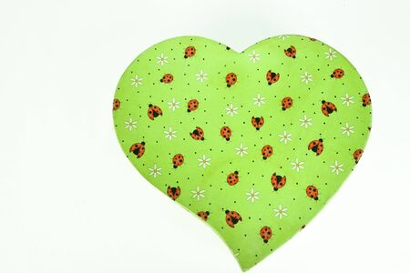 beautiful heart shaped gift box with green texture with patterned images on white background